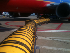 PCA hose trolley extended to aircraft